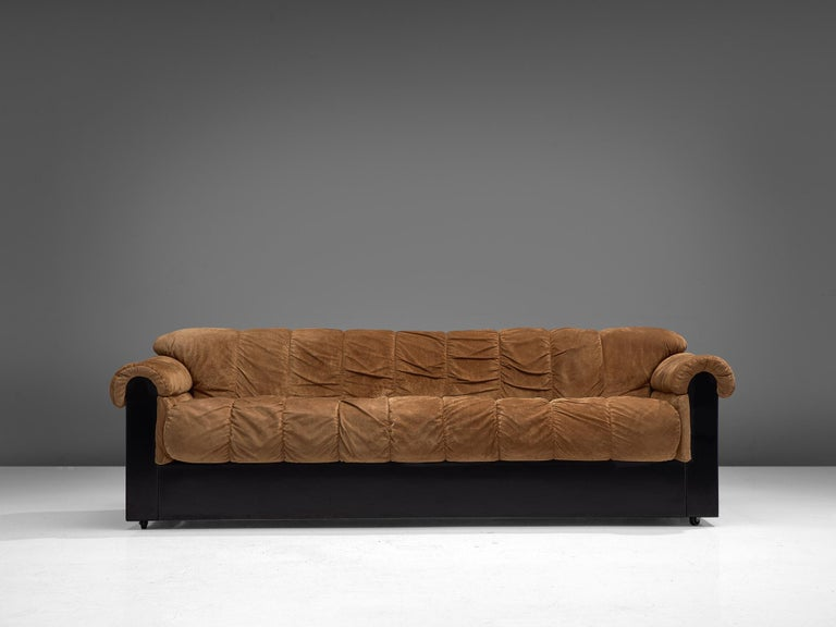 Sofa, alcantara and lacquered polyester, Italy, 1970s.  Bulky and sturdy sofa by Italian design from the 1970s. The sofa features a black lacquered polyester base build up from straight, clean lines. The brown upholstery is draped over the base,