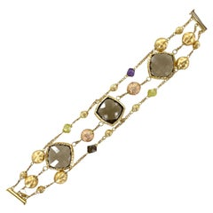 Italian Three Strand Topaz Peridot Amethyst 18 Karat Yellow Gold Bracelet