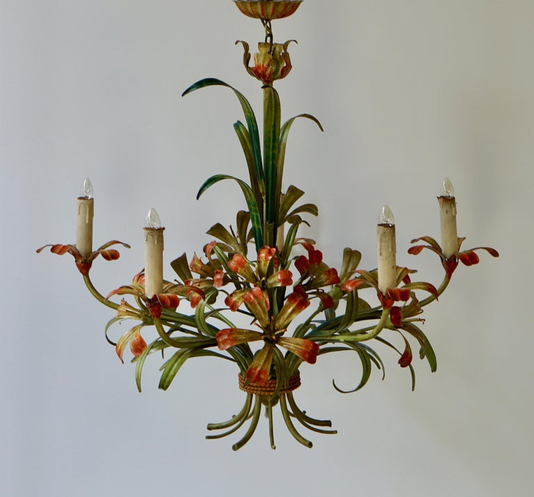 A cheery painted Italian five-light tôle flower chandelier from the 1920s. The five lights sprout from upturned flowers.