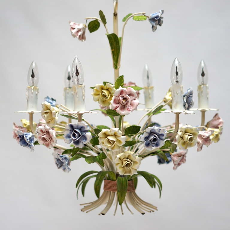 This is a very beautiful painted metal chandelier. The whole piece is adorned with porcelain flowers. 