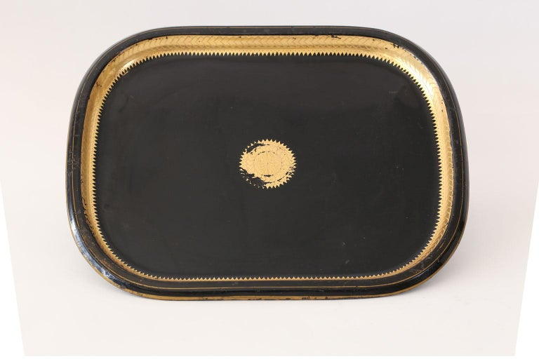 Italian tole tray dating to the early 19th century. Decorated in gilding and painted black.