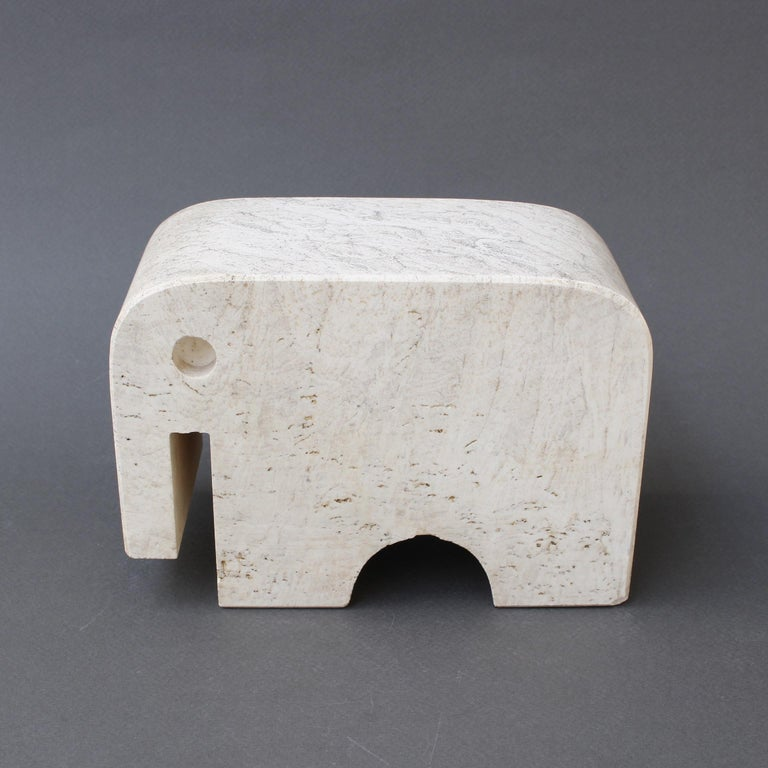Travertine elephant table sculpture by Mannelli Bros., Florence, Italy (circa 1970s). Joyful travertine stylized elephant will delight art lovers and collectors. Minimalist in style with soft curves and lines, this sculpture may be displayed as a