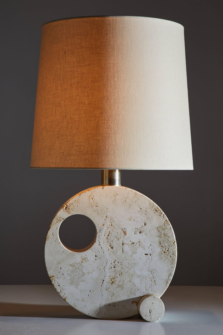 Italian travertine table lamp manufactured in Italy circa 1970s. Original cord and custom linen shade. Takes one E27 100w maximum bulb.