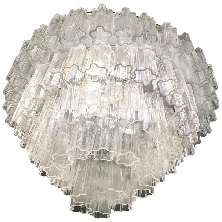 A very fine chandelier in the style Toni Zuccheri for Venini, each one composed by 100 truncated hand blown cylindrical glass pieces. Measure: Height each 25 cm.