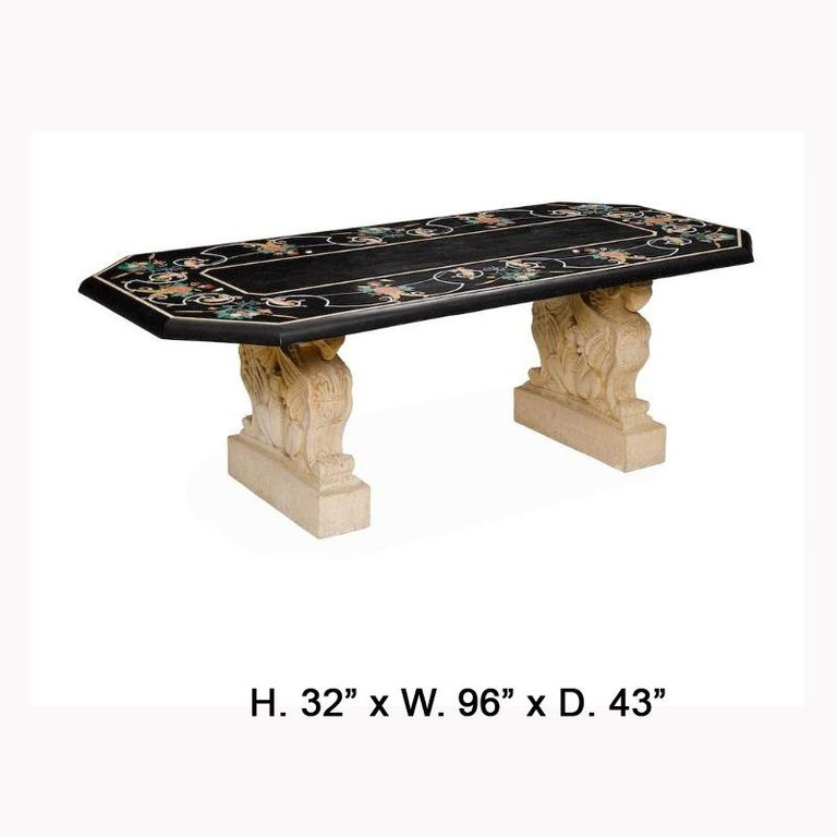 Exquisite Italian Variegated marble inlaid and veneered dining table. 20th century.  A shaped Pietra Dura style inlaid and veneered variegated marble top decorated with fruiting boughs within foliage and scrolls, over two supports depicting four