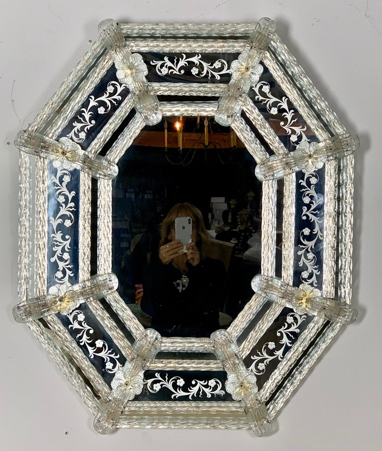 Octagonal shaped Venetian etched mirror made in Venetian glass and detailed with hand blown flowers, leaves, and so much more. There are gold flecks remaining on some of the flowers.