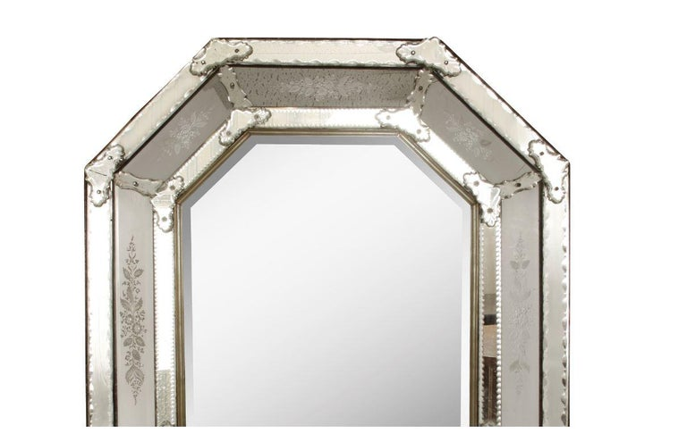 Octagonal Venetian cushion mirror with floral etched detail and applied mirror and glass accents.