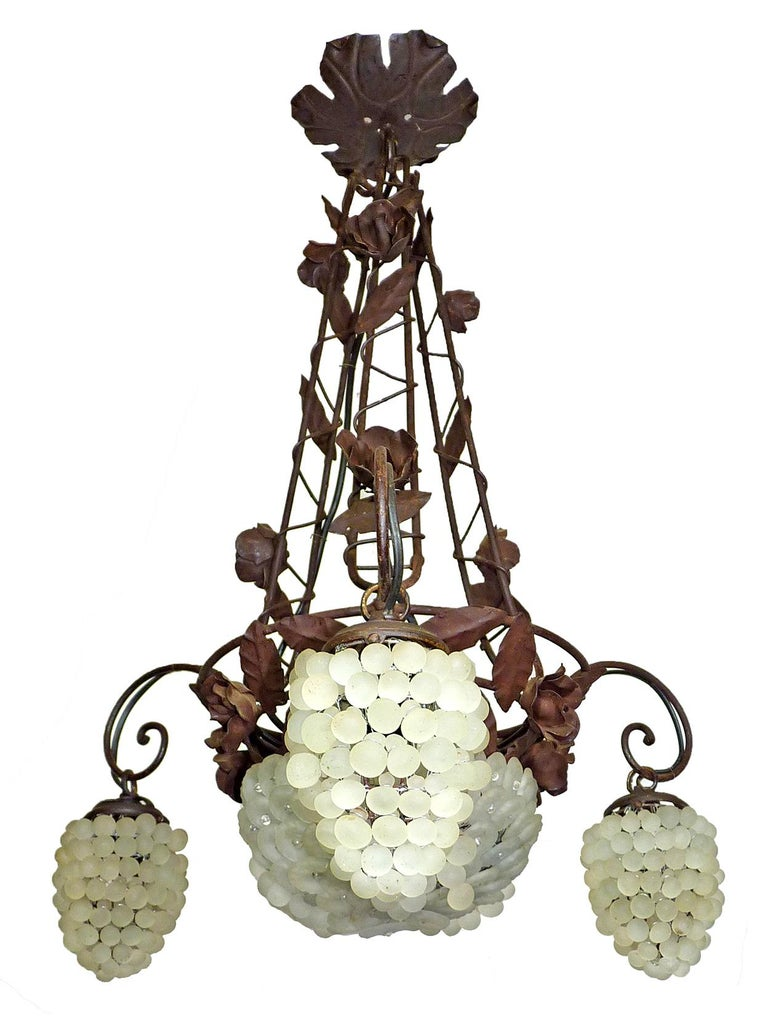 Beautiful original Italian Venetian Murano three-arm white grapes chandelier. The hand forged wrought iron frame features intricately hand forged roses and leaf accents.