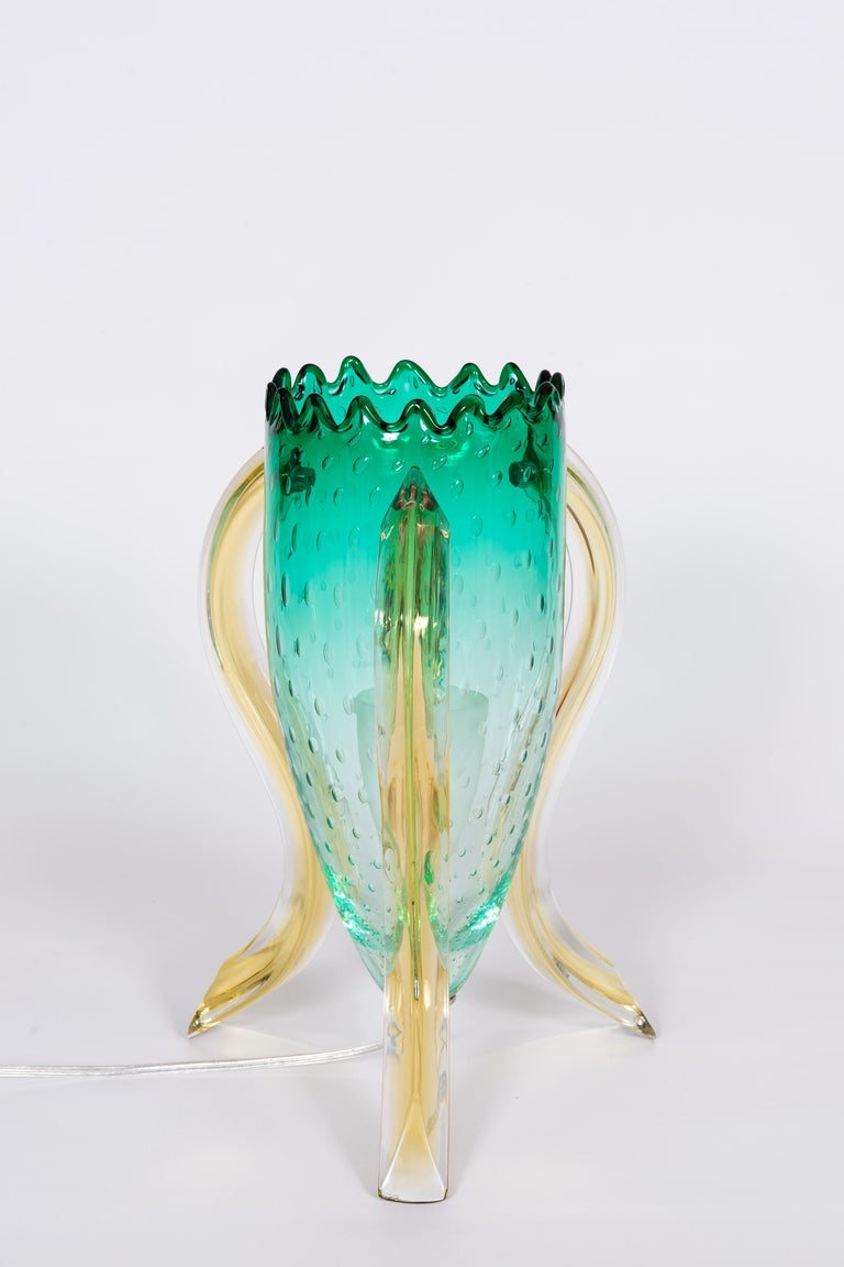 Astonished and unique limited edition, Italian Pair of Table Lamps in Blown Murano Glass Green and Amber, 1990s. Limited Edition. This astonished pair of table lamp, is a unique design, by our Gallery, Vintage Murano Gallery. They are made up of a