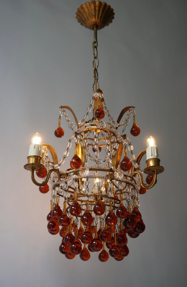 A lovely vintage Venini style chandelier three-light with Murano amber glass teardrops, brass mounts, Italy, 1950s. 