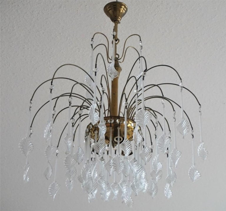 A lovely vintage Venini style chandelier with Murano glass leaves, brass mounts, aged patina to brass, Italy, 1960s