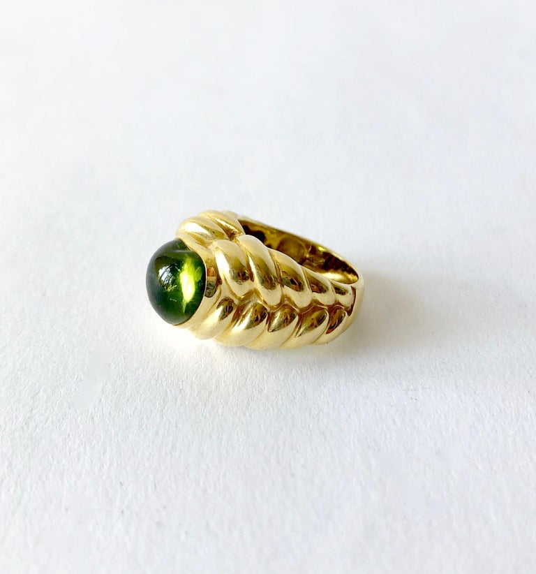 Heart shaped peridot stone set in 18k gold ring by Vesco of Italy.  Ring is a finger size 6 to 6.5 and is signed with Italian hallmark, 750.  In very good vintage condition.  11.9 grams.