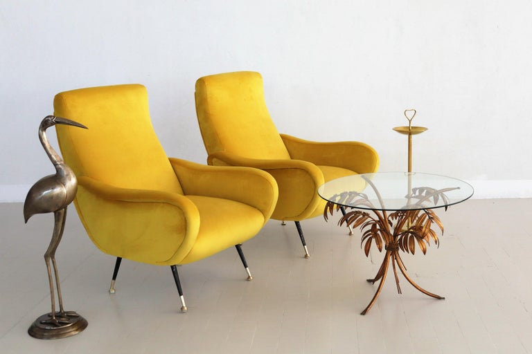 Gorgeous and colorful pair of two Italian original midcentury armchairs or lounge chairs from the 1950s with brass stiletto tips. Completely restored internally with quality material and outside reupholstered with soft Italian velvet in sunny
