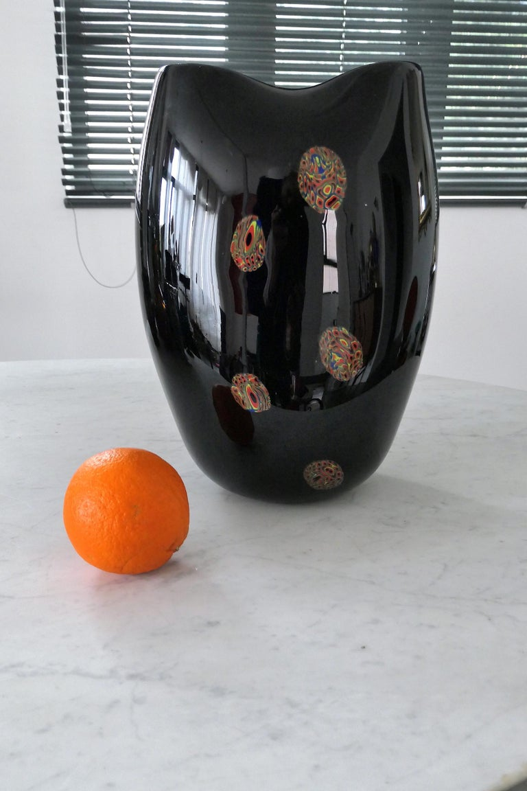 A grand Italian 20th century vintage Venetian Murano decorative vase crafted in Sommerso technique with millefiori inspired specks of bright orange, yellow and blue. Italy, circa 1970s.  All our pieces are fully restored at our atelier and we