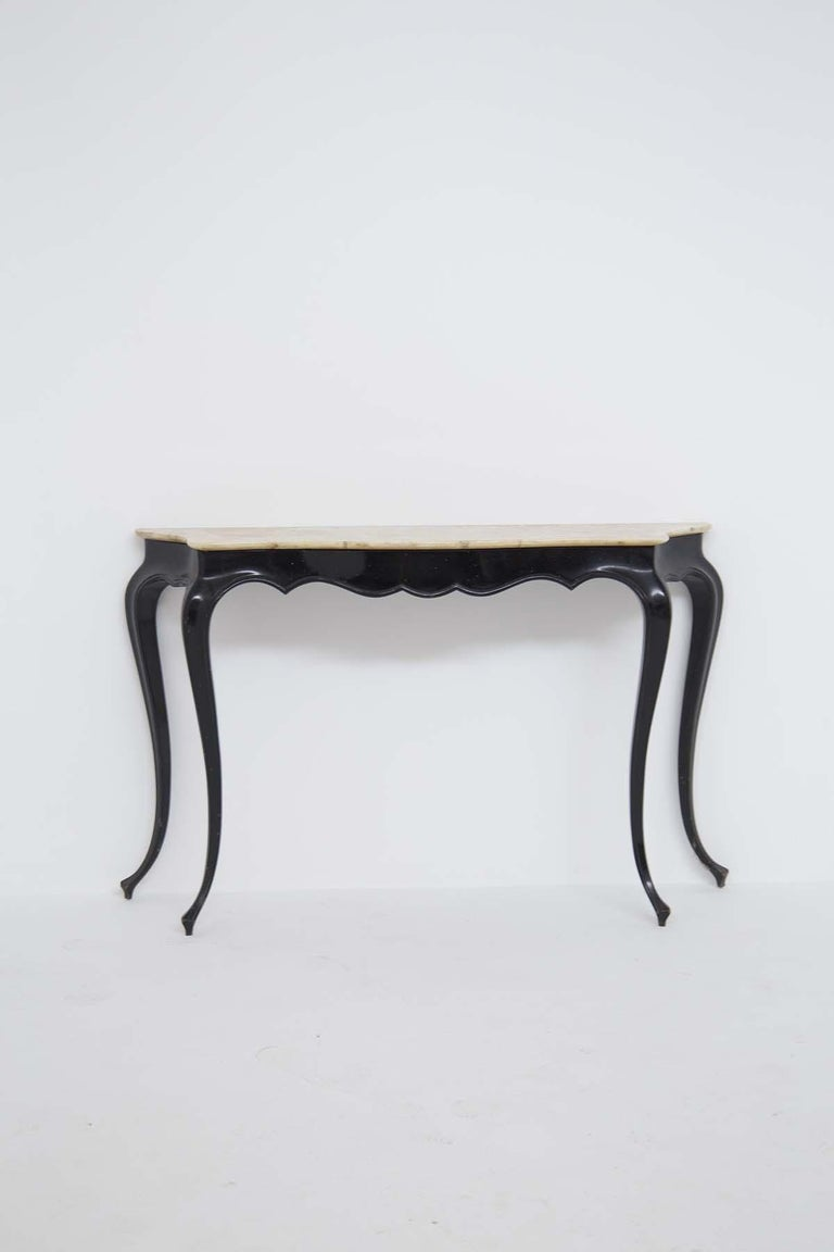 Beautiful console designed by Carlo Enrico Rava in the '50s. Carlo Enrico Rava's console was made with ebonized wood lacquered in black for the legs and the structure, while for the top was used precious marble in shades of ivory. The legs of the
