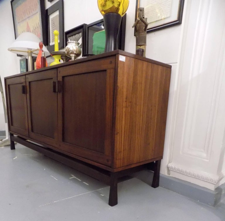 A stunning three-door credenza or sideboard with internal drawer unit with 3 pull-out service drawers.