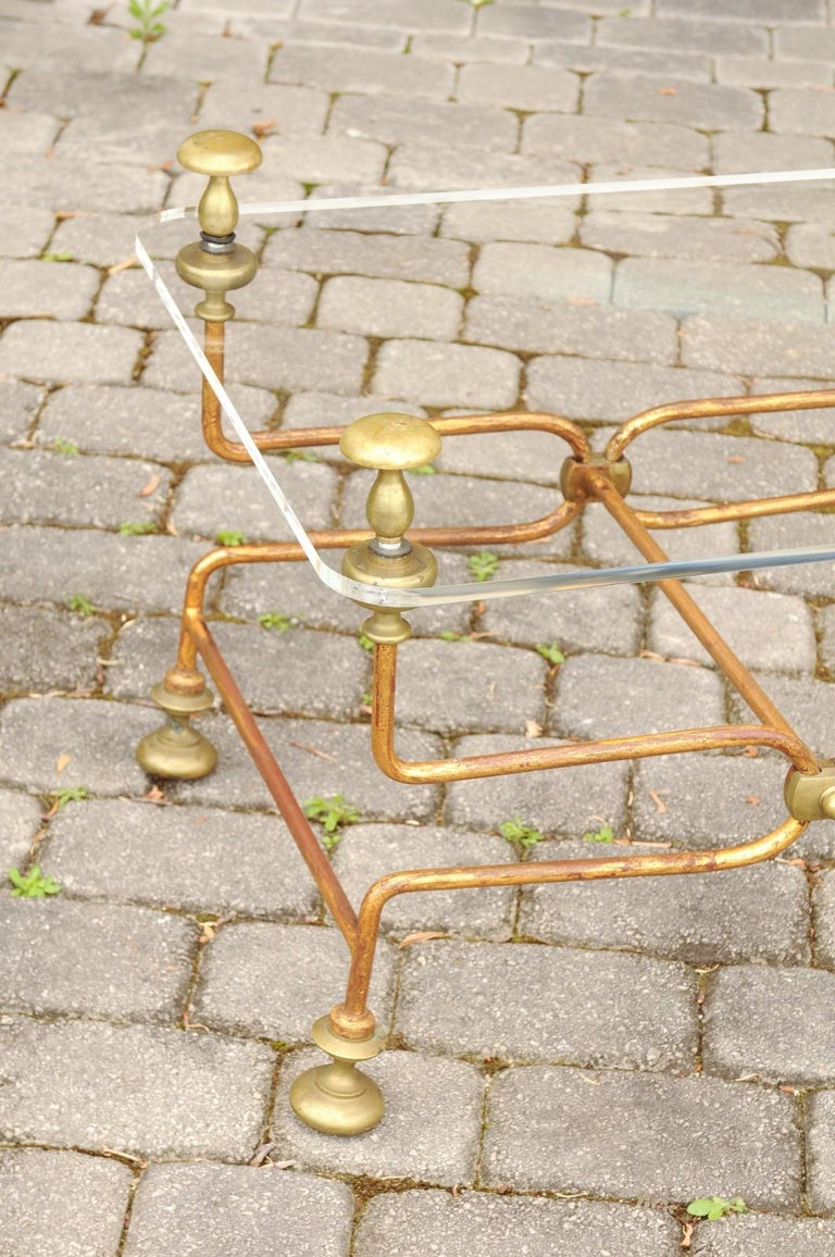 Italian Vintage Midcentury Brass Cocktail Table with Lucite Top and Looping Base In Good Condition For Sale In Atlanta, GA