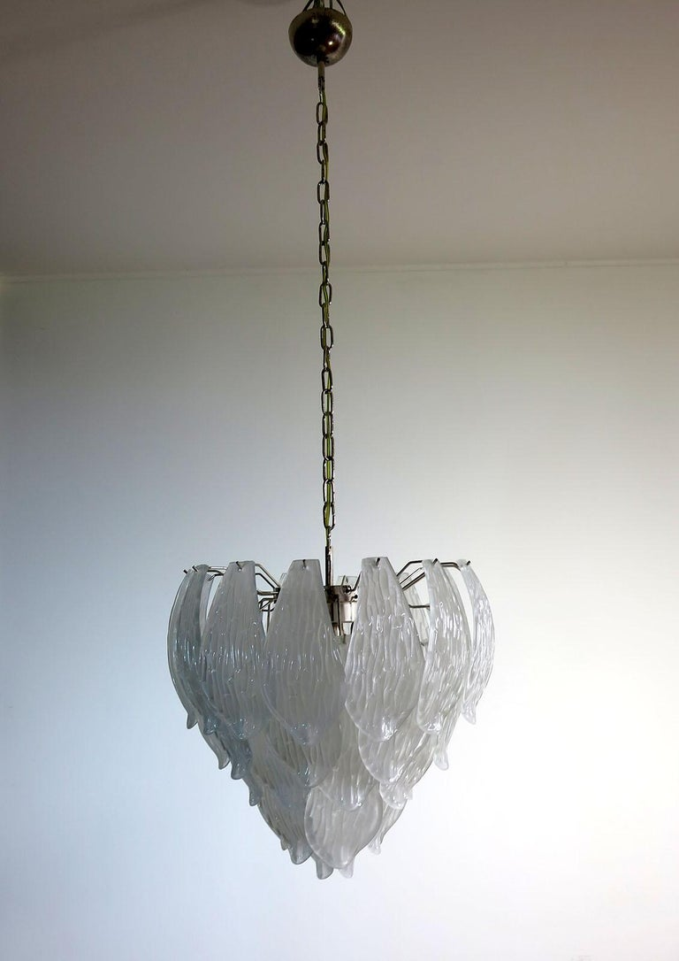 Huge Italian vintage Murano chandelier made by 41 hand blown transparent frosted carved glass leaves in a chrome frame. Period: 1970s-1980s Dimensions: 49.20 inches (125 cm) height with chain, 25.80 inches (68 cm) height without chain, 21.25