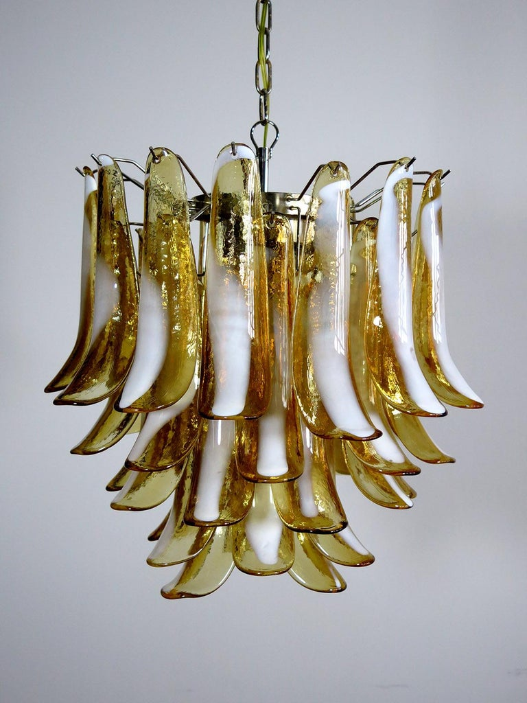 "1970's Murano Italian glass chandelier. Fantastic chandelier with caramel and white ""lattimo"" glasses, nickel-plated metal frame. It has 41 big monumental petals glass. The glasses are very high quality, the photos do not do the beauty, luster of"