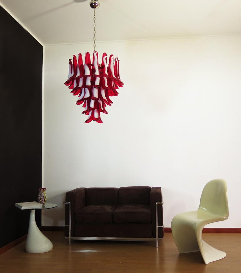 """Huge Italian vintage Murano chandelier made by 52 glass petals (red and white """"lattimo"""") in a chrome frame. Period: Late 20th century Dimensions: 55.10 inches (140 cm) height with chain; 29.50 inches (75 cm) height without chain; 26 inches (66 cm)"""