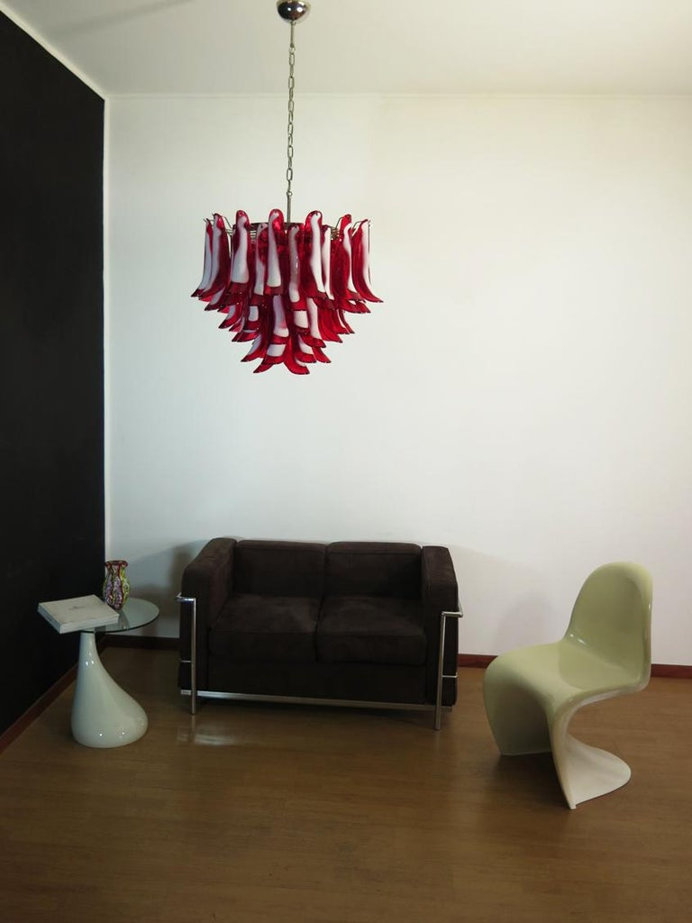 """Murano Italian glass chandelier. Fantastic chandelier with red and white """"lattimo"""" glasses, nickel-plated metal frame. It has 53 big monumental petals glass. The glasses are very high quality, the photos do not do the beauty, luster of these"""
