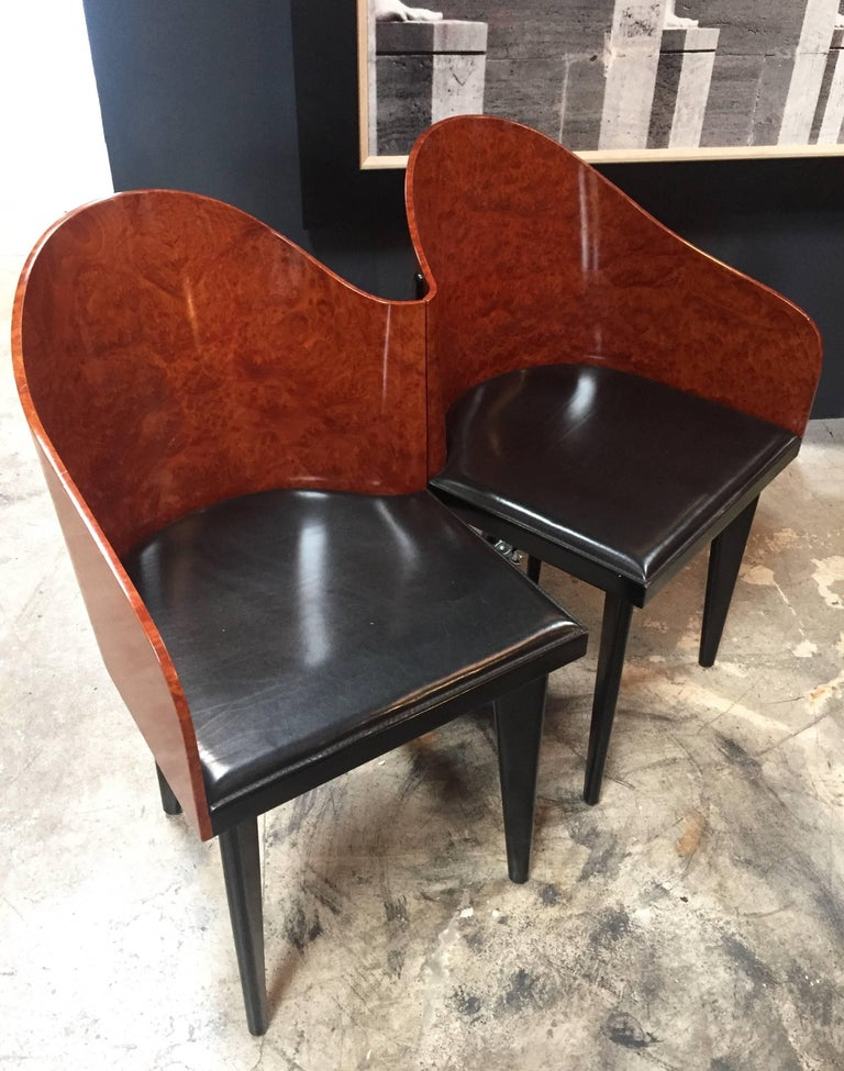 A great rare pair of 1980s design Italian asymmetrical chairs by Fratelli Saporiti. They have black leather seats and mahogany backs with a curvilinear shape.