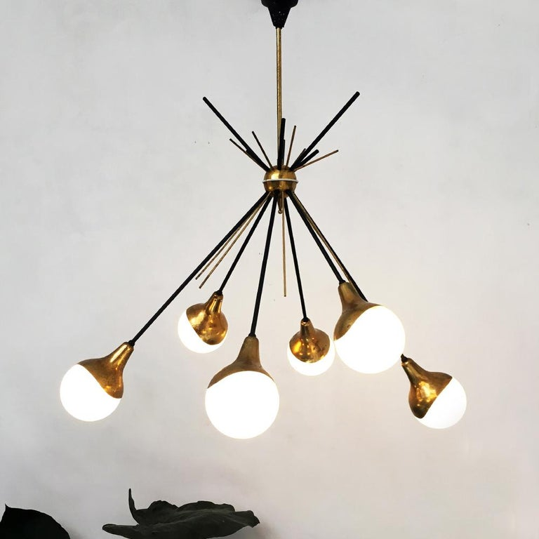 Italian vintage six lights Sputnik chandelier by Stilnovo, 1950s Six lights Sputnik chandelier with satin opal glass lampshade and brass structure and black metal rod. Made by Stilnovo in the 1950s. Excellent condition and in patina. Measures: 70