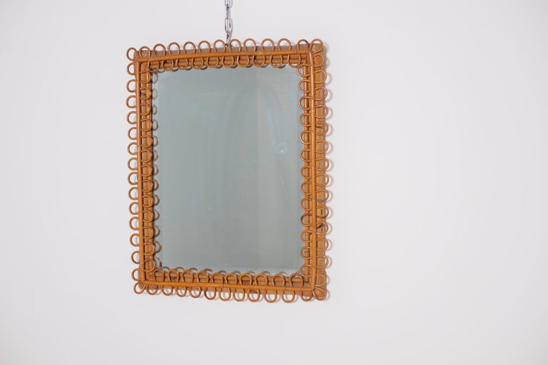 Beautiful Italian mirror from the midcentury, 1950s. The mirror is in perfect vintage condition. Made entirely of bamboo it recalls a jungle and safari style. Its particularity is its bamboo frame made in torchon. The mirror is ideal for safari