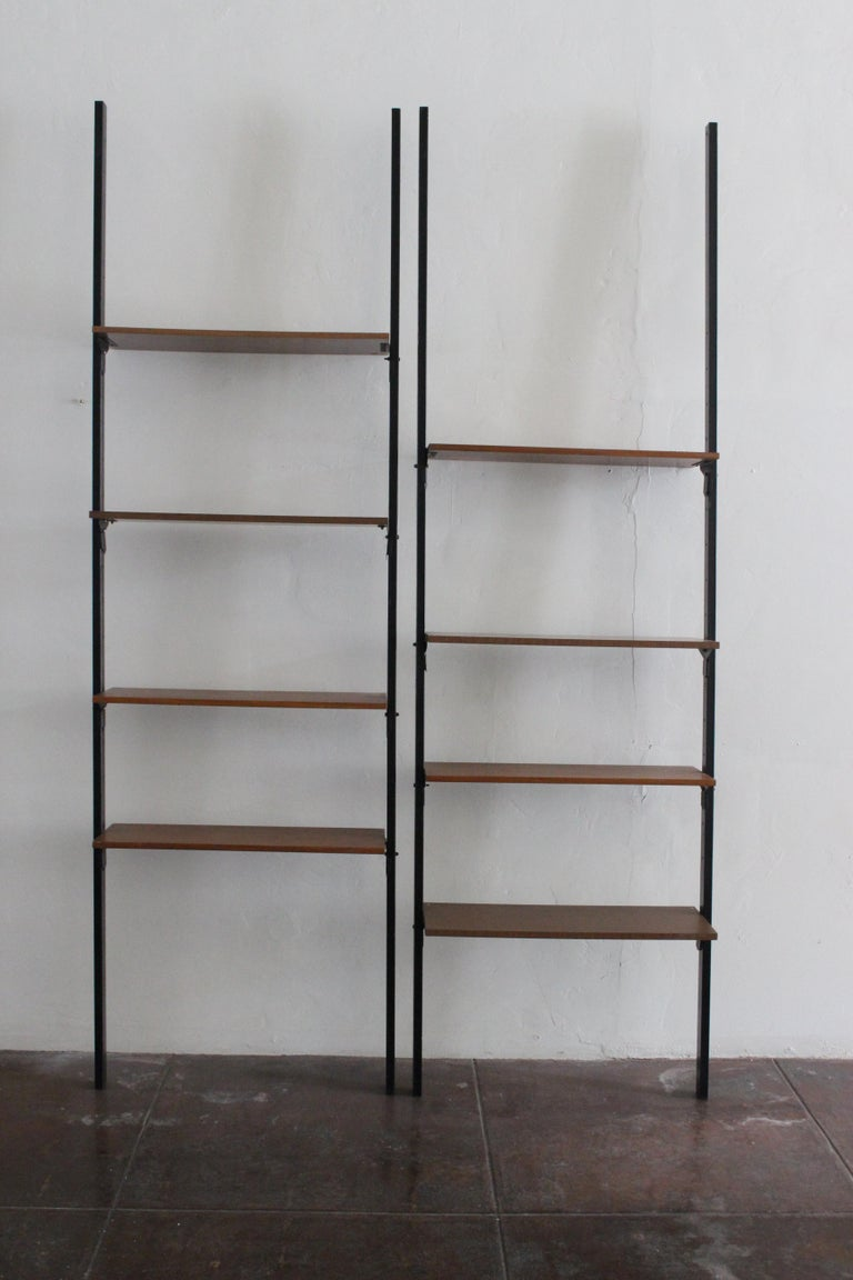Tall midcentury metal shelves, adjustable shelving position metal base with Formica veneer. The shelves can be disassemble as shown on the photos all of them are on the screws.