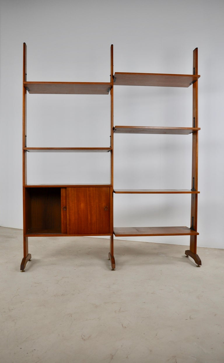 Italian wall unit composed of three uprights, a box with two sliding doors and six boards. The boards and the box can be positioned where you want and therefore modulated to your own way your wall unit. It can be completely dismantled and is very