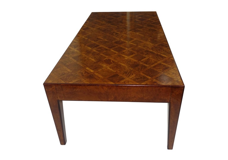 Vintage walnut and burl walnut coffee table with parquetry design standing on square tapering legs, Italian, circa 1960.