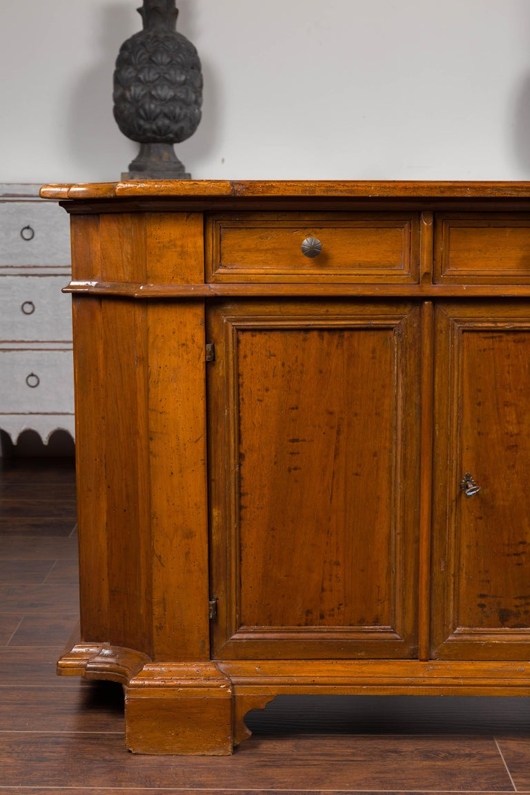 Italian Walnut Credenza with Drawers over Doors and Curving Sides, circa 1860 2