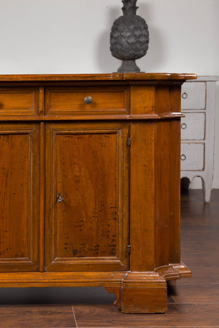 Italian Walnut Credenza with Drawers over Doors and Curving Sides, circa 1860 3