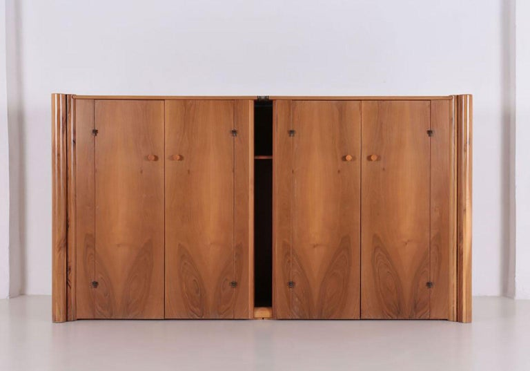 Scuderia sideboard, designed by Carlo Scarpa in 1977 for Bernini. Italian walnut horizontal four doors sideboard with double cylindrical elements on either side.