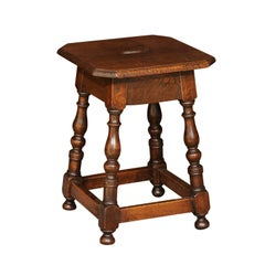 Italian Walnut Stool with Splayed Legs and Pierced Handle from the 1820s