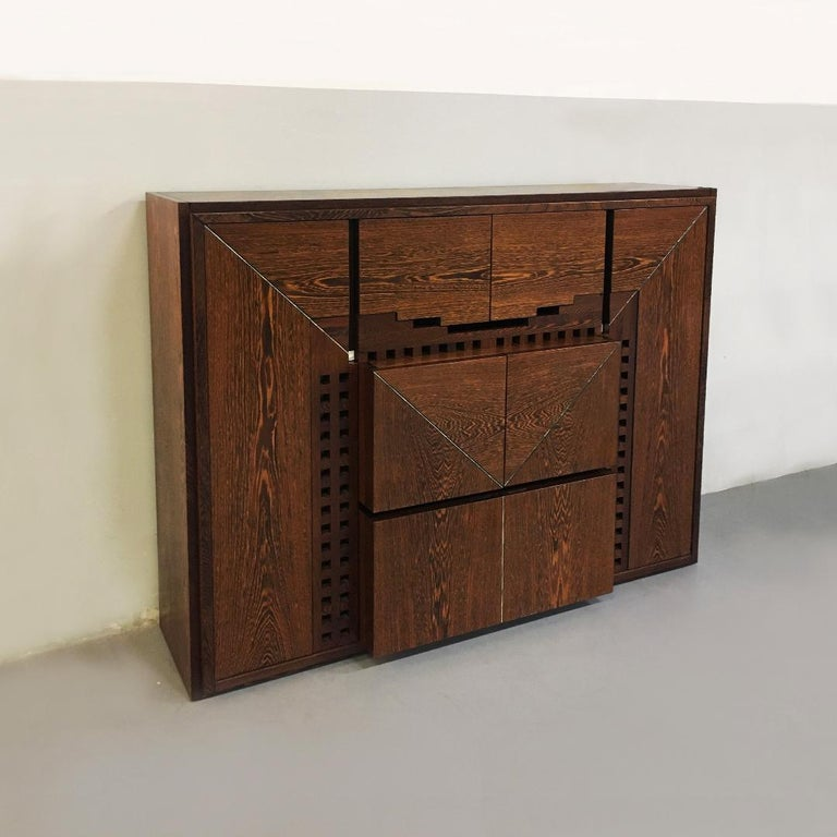 Italian Wengé cabinet Micene by F. Meccani for Meccani Arredamenti, 1978. solid wengé cabinet Micene with eight doors and eight shelves, one drawer, inlaid with mother of pearl.  Very good condition  Measures: 150 x 192 x 57 cm.