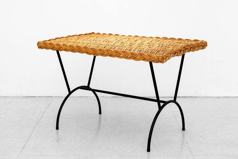 Italian wicker coffee table with iron base and woven braided wicker detail.