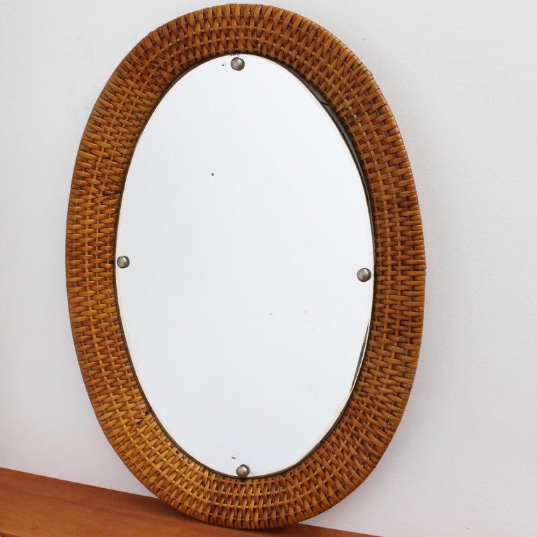 Mid-20th Century Italian Wicker Rattan Oval-Shaped Wall Mirror, circa 1960s For Sale