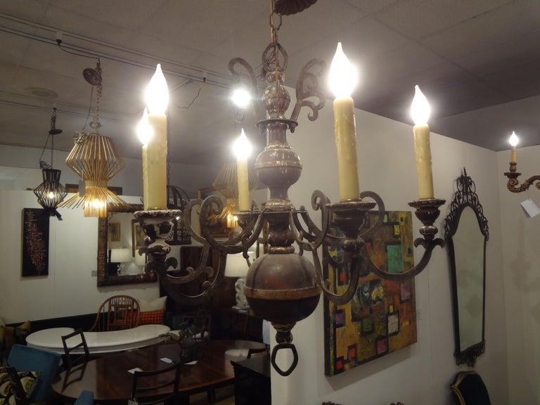 Stunning Italian wood and iron six-light chandelier. This chandelier is perfect for older homes with lower ceiling heights. Great distressed look with some gesso loss which gives it a much older look than it actually is. This Italian chandelier has