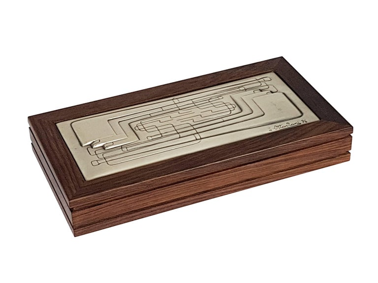 This vintage box is made from a wooden structure with a silver decoration lid. It was designed and manufactured by Ottaviani Silverware in 1976. Signature and date imprinted by maker. The box remains in very good vintage condition: light wear
