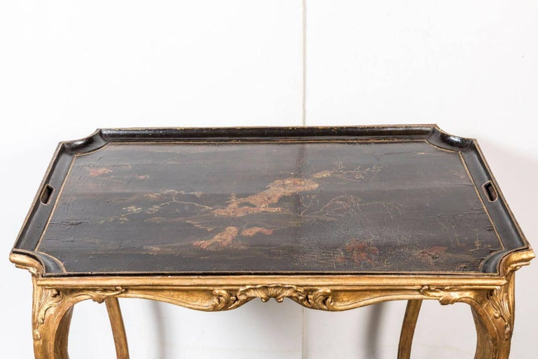 Completely original, cabriole leg, concave-corner hand-carved and gilded tray table with removable inset, lacquered and painted chinoiserie serving tray.
