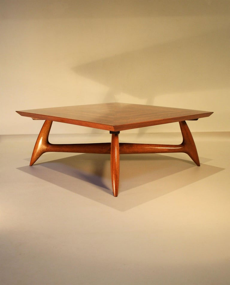 Rare coffee table by Pierluigi Giordani made from walnut, circa 1955. The square table top has a beautiful veneered walnut inlay of four parts and the biomorphic shaped base is made of solid walnut. The whole is in very good condition and on photo 8