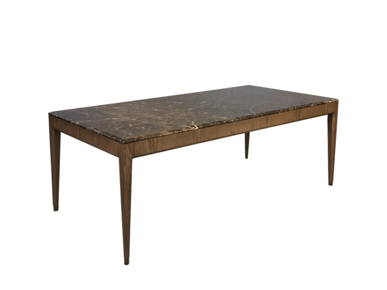 Contemporary style Italo dining table made of ashwood with marble top and brass tips.