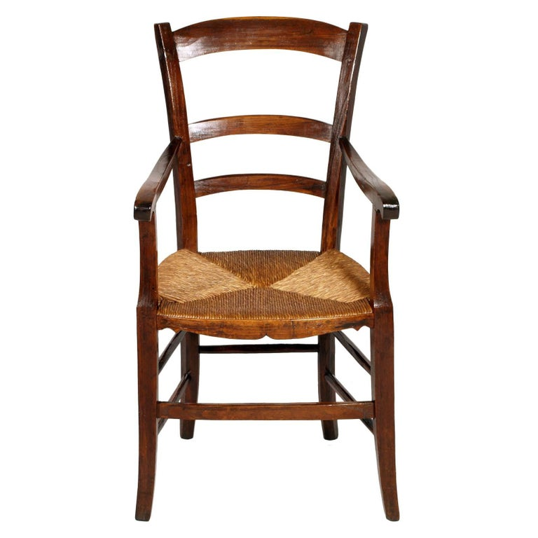 Italian 18th century country rustic robust armchair in chestnut wood hand cut, restored and polished with shellac and wax. Straw seat in excellent condition Measures cm: H 102\48 x W 54 x D 51.