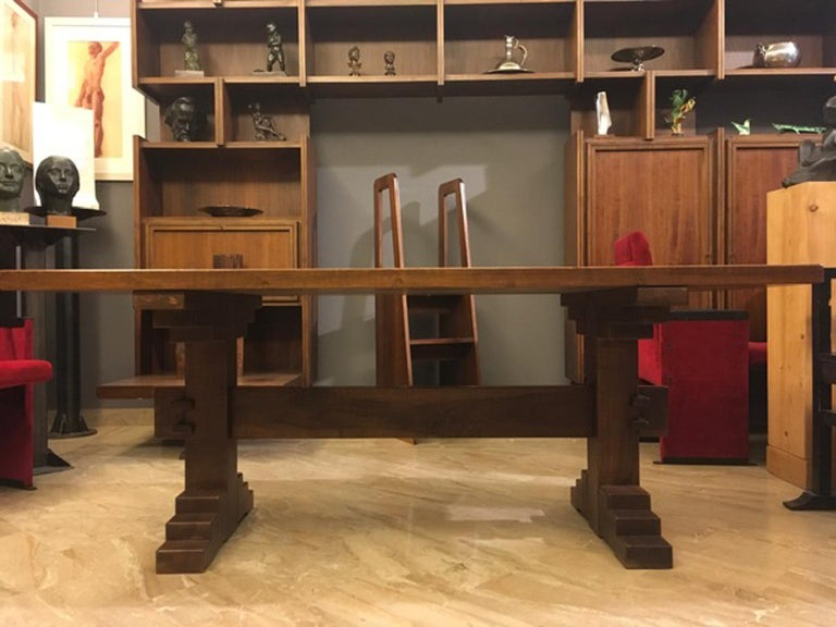 This solid table was handmade by Officina Rivadossi, Italy, and on the top it shows the characteristics lines of this factory, dues to the craftsman work. This is a factory marks for collectors and the sign which distinguished Officina Rivadossi all