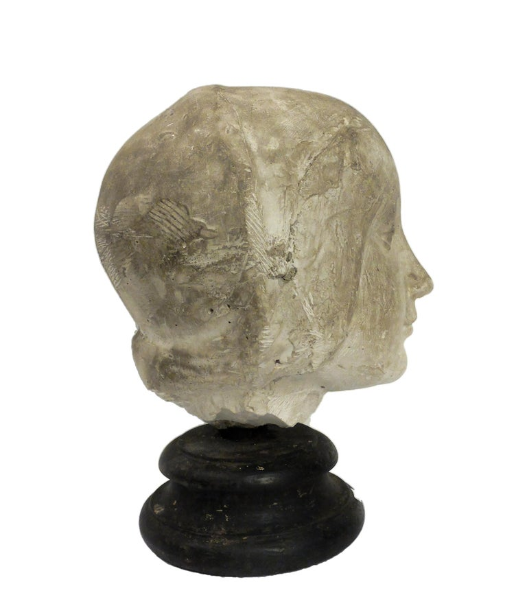 Over the wooden black painted base is set the cast of Eleonora D'Aragona head Cast for drawing teaching of student in Academy. Made out of plaster with wheel turned fruitwood ebonized base, circa 1890.