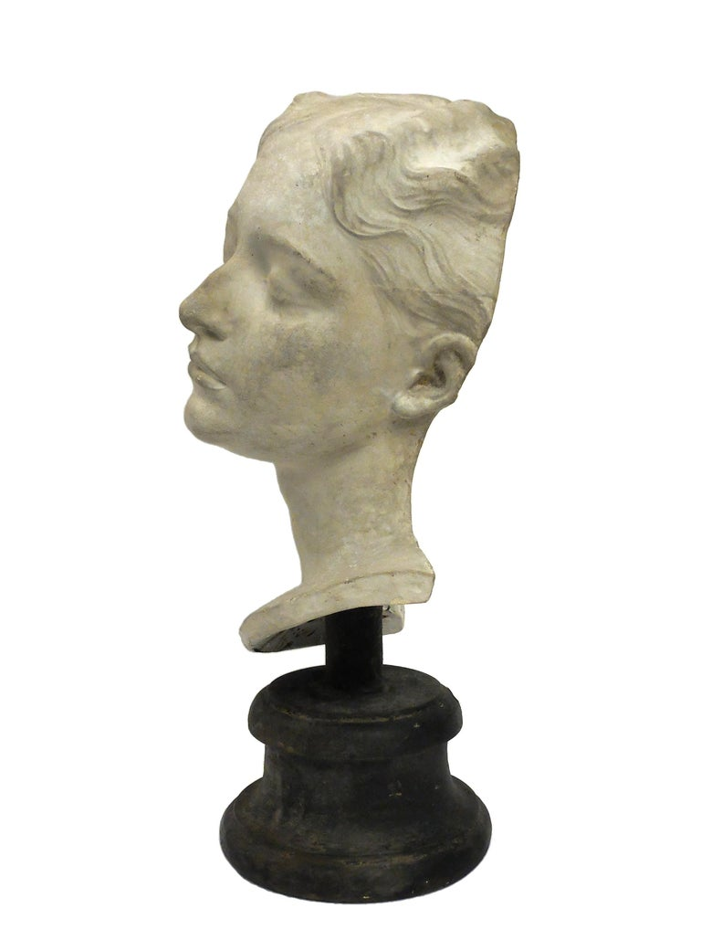 Over the wooden black painted base is set the superb cast of a young girl's head. The cast for drawing teaching in Academy, Italy, circa 1890.
