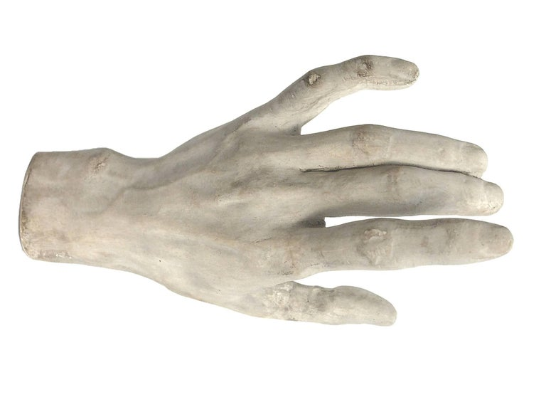A plaster depicting a hand cast for drawing teaching in Academy, Italy, circa 1890.