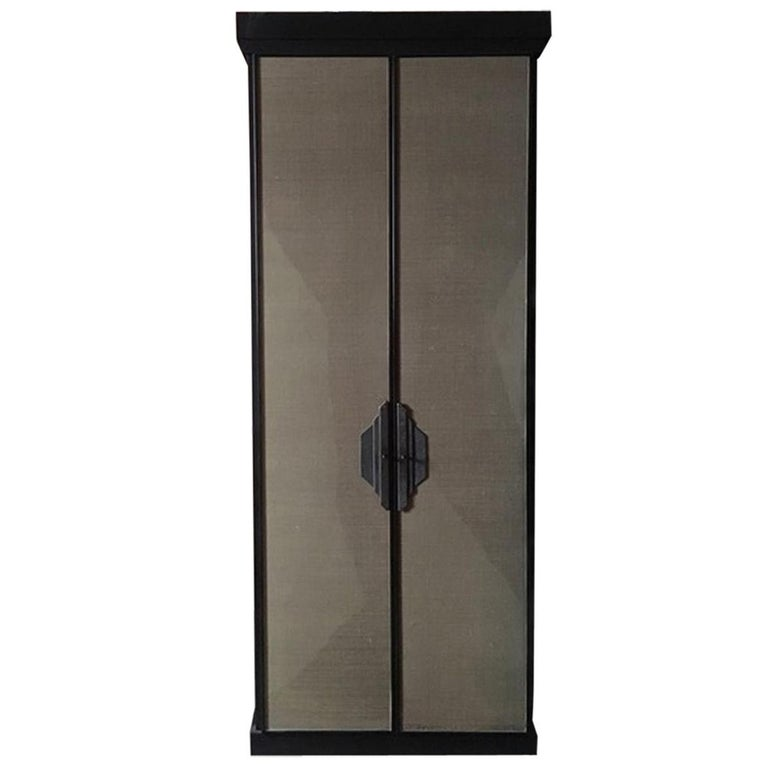 This is a very beautiful pair of cabinets, one of a kind, for the slim proportion, the bronze handles, fully handmade and designed by studio Dimore. The color is wenghè Inside there are shelves.  The raffia panels have imperfections due to the