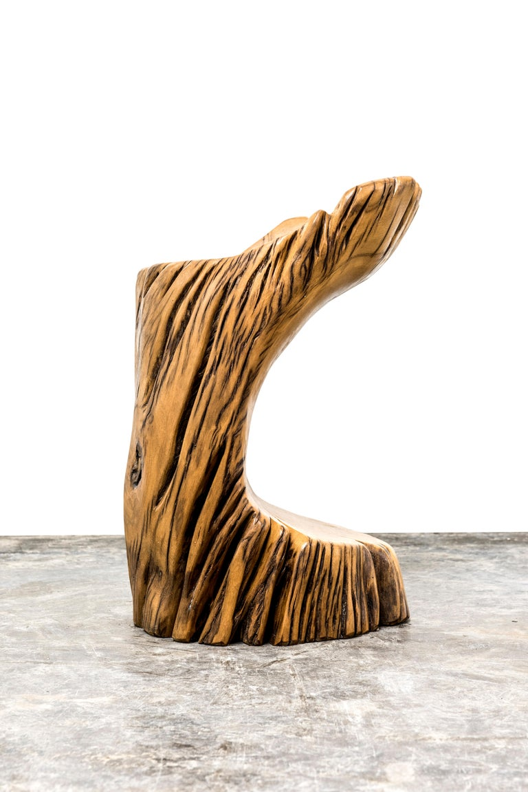 Stool made out of reclaimed Pequi wood by Hugo França.